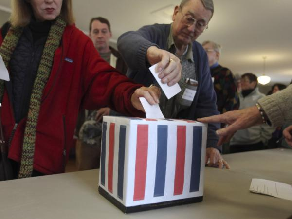 With its quirky caucuses and wacky candidate selection, the American political system may not be perfect, but it's a work in progress. Voters cast a ballot during the Harpswell Republican town caucus at the Old Orr's Island School House in Harpswell, Maine, on Feb. 11.