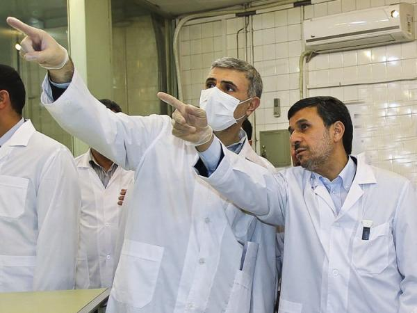 Iranian President Mahmoud Ahmadinejad (right) listens to a nuclear expert during a tour of the Tehran Research Reactor on Wednesday. Iran announced that for the first time it has produced the fuel plates that power that reactor.