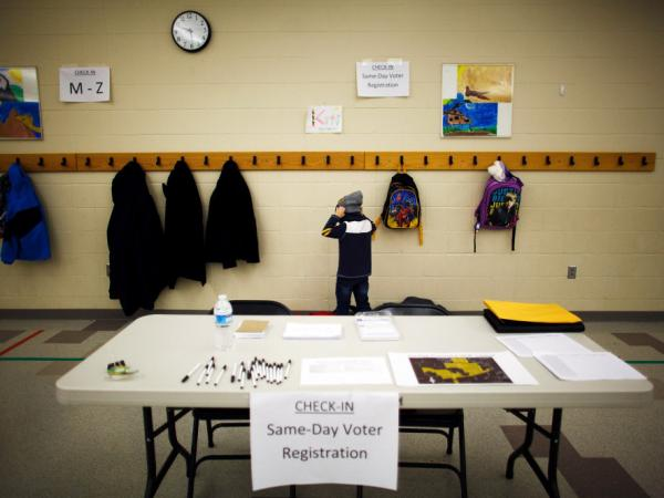 A young boy prepares to leave school before the arrival of voters at the Waukee Precinct 4 GOP Caucus held at Walnut Hills Elementary School Jan. 3, 2012 in Urbandale, Iowa. Some analysts expect a weak youth vote in 2012.