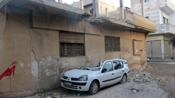 A handout picture from a Syrian opposition activist taken on Feb. 13 shows damages in the Baba Amro neighborhood in the flashpoint Syrian city of Homs.