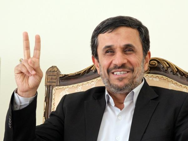 Iranian President Mahmoud Ahmadinejad flashes the V-sign for victory as he waits for the arrival of Ismail Haniya, Palestinian Hamas premier in the Gaza Strip, for a meeting in Tehran on Feb. 12, 2012. Some are concerned about the possibility of conflict with Iran.
