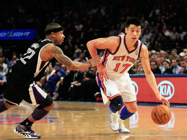 Jeremy Lin #17 of the New York Knicks drives past Isaiah Thomas #22 of the Sacramento Kings at Madison Square Garden on February 15, 2012 in New York City.