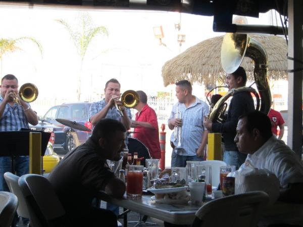 La Banda Rebelde charges twice as much per song as a band without a tuba charges. People have been known to throw hundred-dollar bills into the tubist's horn to show their appreciation.