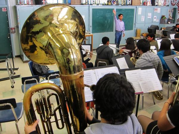 Teacher Ruben Gonzalez conducts the South Gate High School band. According to Gonzalez, thieves passed up a computer as well as a stash of valuable flutes, saxophones and clarinets to get to the school's tubas.