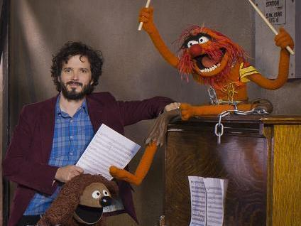 "Bret McKenzie (left) wrote five of the songs in <em>The Muppets</em>, including the Oscar-nominated ""Man or Muppet"" and the opening number, ""Life's a Happy Song."""