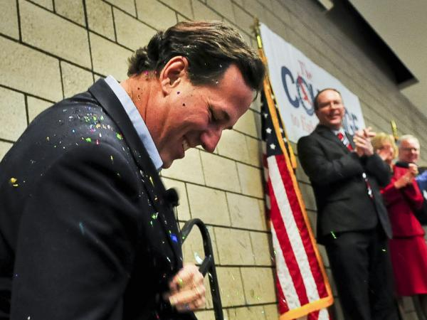 "Republican presidential candidate Rick Santorum brushes off glitter after being ""glitter-bombed"" before a campaign rally on Feb. 7 in Blaine, Minn."