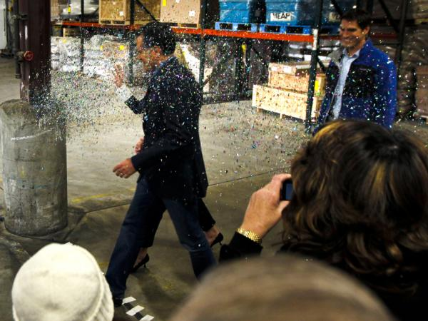 Republican presidential candidate Mitt Romney is glitter-bombed as he walks to the stage at the start of a campaign rally in Eagan, Minn., on Feb. 1.