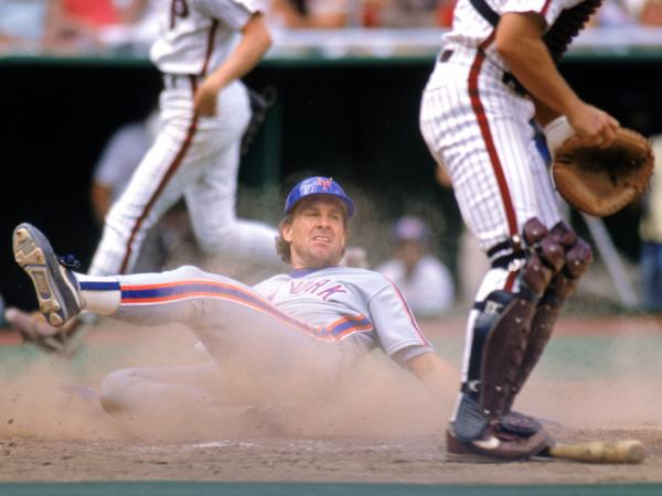 Gary Carter slides over home plate during a New York Mets game in the 1989 season. The Hall of Fame player died Thursday, of brain cancer.