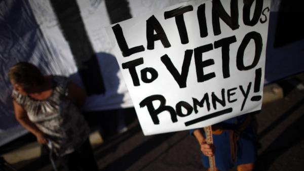 Protesters demonstrate as Republican presidential contender Mitt Romney attends a Get Out the Vote Rally in Mesa, Ariz.