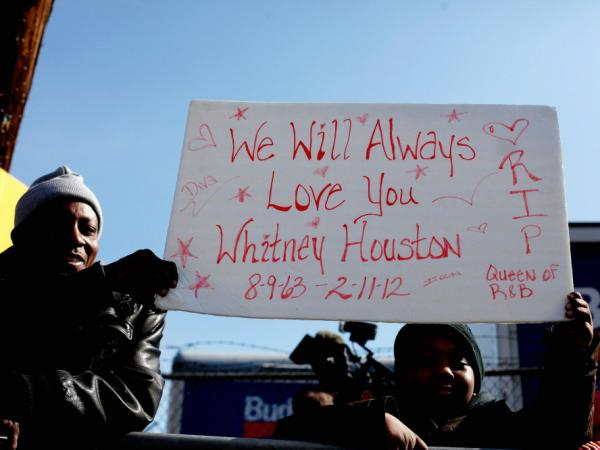 Fans mourn at the funeral service for Whitney Houston in Newark, New Jersey.