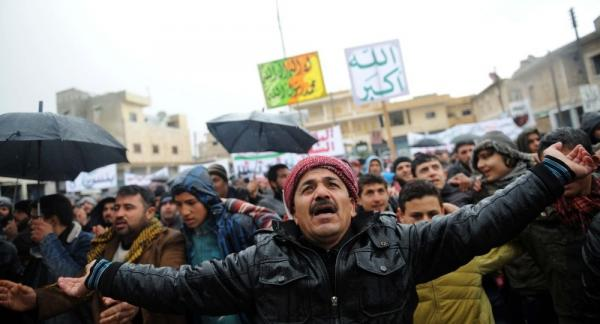 Syrians demonstrate against the regime after Friday prayers in the north Syrian city of Idlib on Friday. Thousands of Syrians rallied to demand Bashar al-Assad's ouster, as the embattled president's forces unleashed their heaviest pounding yet of Homs in a brutal bid to crush dissent, monitors said.