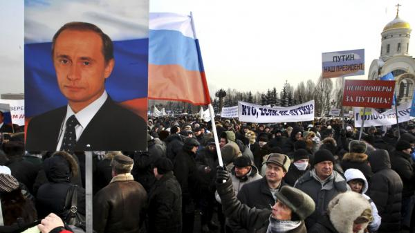 Russians take part in a pro-Putin rally at a Moscow park on Feb. 4. Pro-Kremlin forces have been accused of paying people to attend campaign events ahead of the presidential election in March.