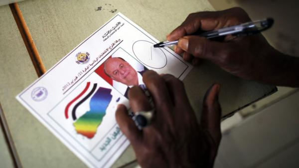 A man casts his vote during Yemen's presidential elections in the southern Yemeni port city of Aden on Tuesday, Feb. 21. Only one person was on the ballot: Vice President Abdrabu Mansour Hadi.