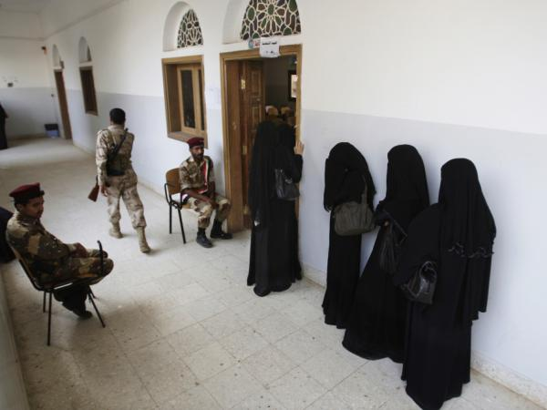 Yemeni women stand in line waiting to cast their votes at a polling station during presidential elections in Sanaa, Yemen, Feb. 21.