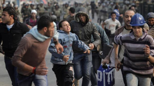 Egyptian protesters are chased by soldiers in Cairo on Dec. 17, 2011. Egyptian soldiers swept into Cairo's Tahrir Square that day, chasing protesters and beating them to the ground with sticks and tossing journalists' TV cameras off balconies. The media in Egypt face direct threats such as these — but also more subtle pressures.