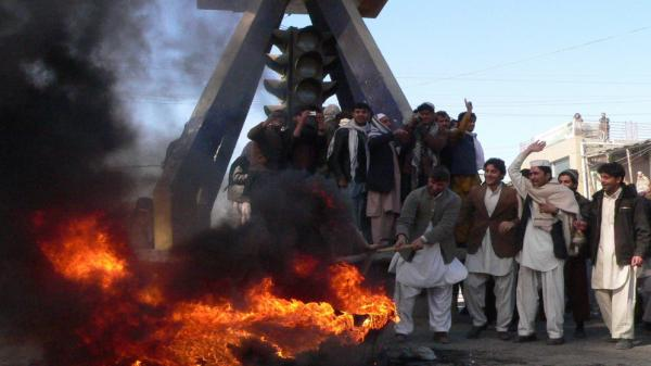 Afghan demonstrators burn an effigy of President Obama and shout anti-U.S. slogans in the eastern city of Jalalabad on Wednesday, Feb. 22. Afghans have been rioting for three days after word that several Qurans were desecrated at a NATO base. The U.S. says the burning of the Qurans was accidental.