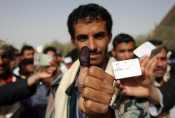 A Yemeni man shows his ink-stained thumb after he voted in the presidential election in Yemen's capital on Feb. 21. The one-candidate election ends President Ali Abdullah Saleh's 33-year hard-line rule.