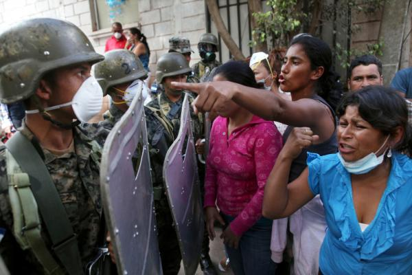 In Honduras, female relatives of inmates killed during a fire at a prison argue with soldiers as they try to enter the morgue in Tegucigalpa, the Honduran capital, on Feb. 20. The fire at Comayagua prison on Feb. 14 killed more than 300 inmates.