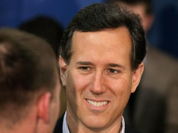 Republican presidential candidate Rick Santorum greets supporters following a campaign rally at the Heritage Christian Academy on Feb. 27, 2012 in Kalamazoo, Michigan. Michigan residents will go to the polls on Feb. 28 to vote their choice for the Republican presidential nominee.