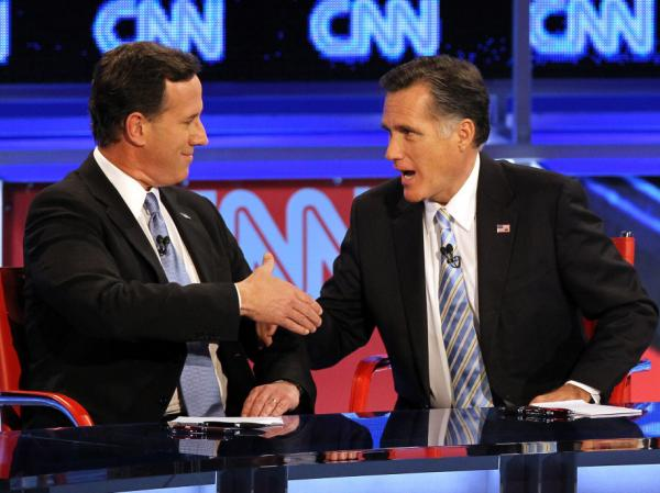 Republican presidential candidates Rick Santorum and Mitt Romney talk after participating in a debate on Feb. 22, 2012 in Mesa, Arizona. The debate was the last one scheduled before voters head to the polls in Michigan and Arizona's primaries on Feb. 28 and Super Tuesday on March 6.