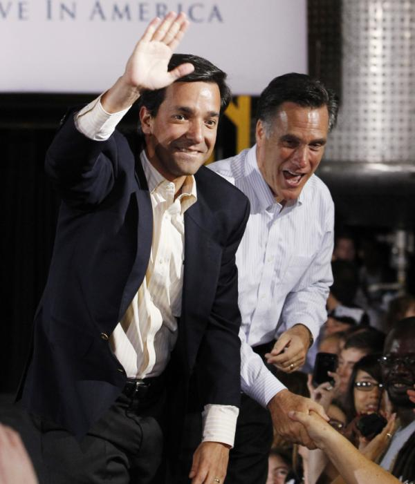 Mitt Romney campaigns with Puerto Rican Gov. Luis Fortuno at Lanco Paint Co. in Orlando, Fla., last month. The Puerto Rico's March 18 primary could be a significant source of delegates for the GOP candidates.