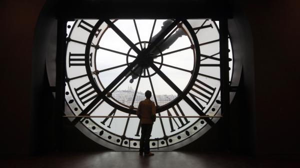Leap day is the perfect moment to contemplate time. Here a man looks at the Seine river through the giant clock of the Orsay Museum in Paris.