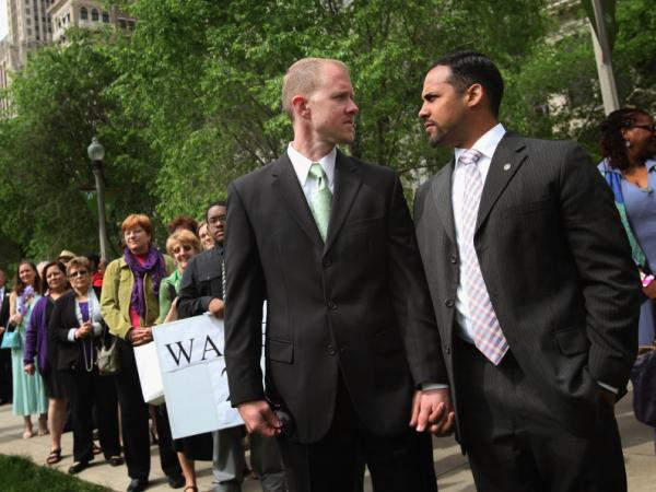 Ryan Witmer (left) and Jhonmar Castillo wait with other couples to exchange vows in a civil union ceremony June 2 in Chicago's Millennium Park. New data from the U.S. census may reveal as much about changing attitudes as about changing numbers.