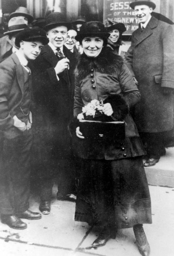 Margaret Sanger, who established Planned Parenthood, poses in 1916 outside the Brooklyn Court of Special Sessions after her arraignment for distributing information about contraceptives in New York.