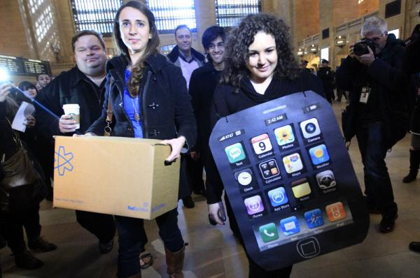 Sarah Ryan, left, and Shelby Knox, with Change.org arrive at the Apple store at Grand Central to deliver petitions asking Apple to change its manufacturing practices.