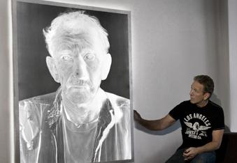 Dennis Manarchy with one of his 6-foot-tall negatives.