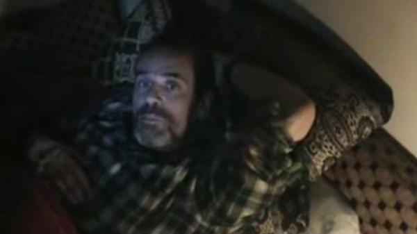 An image grab from a video uploaded on YouTube shows Paul Conroy in the Syrian city of Homs.