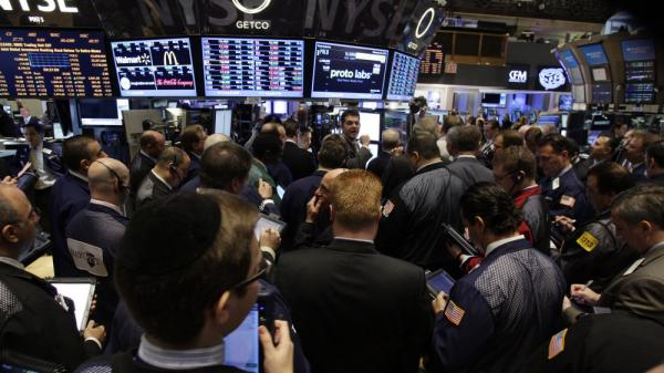 Traders work on the floor of the New York Stock Exchange moments after the opening bell Feb. 24.