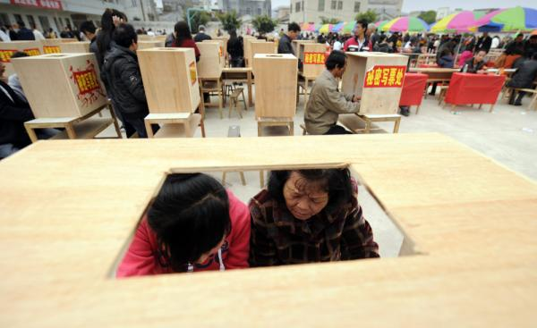 Residents of Wukan in China's southern Guangdong province fill in forms before voting in village elections on Saturday.