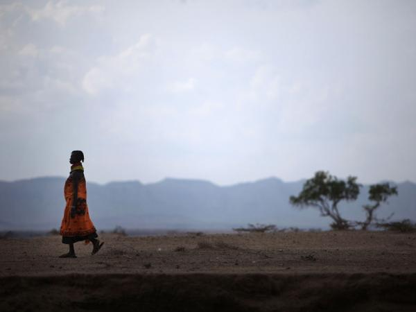 A woman from the remote Turkana tribe in Northern Kenya walks along a dry riverbed near on Nov. 9, 2009 near Lodwar, Kenya. The traditional nomadic life of the pastoralist is coming under increasing pressure in northern Kenya from repeated droughts and political marginalisation.