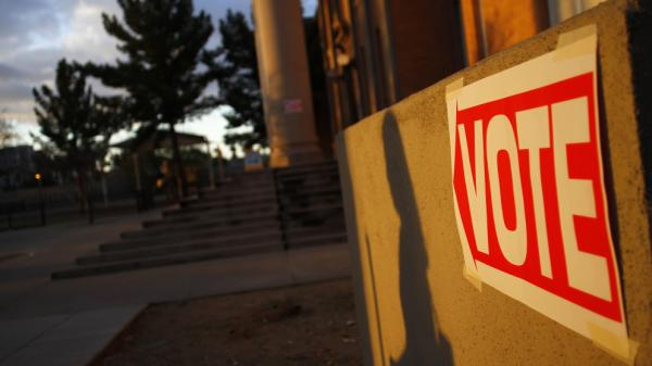 Ten states hold nominating contests on Tuesday. Here, a voter walks to a polling station in Phoenix on Feb. 28, 2012.