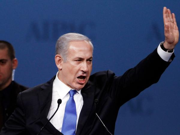 "Israeli Prime Minister Benjamin Netanyahu addresses the American Israel Public Affairs Committee's annual policy conference on Monday in Washington, D.C. He said he would never let his ""people live in the shadow of annihilation."""