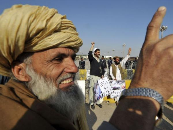 Pakistani tribesmen shout anti-U.S. slogans during a protest in Islamabad on Feb. 25, 2012, against U.S. drone attacks in the Pakistani tribal region. Obama confirmed that drones target Taliban and Al-Qaeda militants on Pakistani soil, but American officials do not discuss details of the covert program.