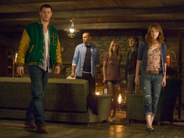 Curt (Chris Hemsworth), Holden (Jesse Williams), Jules (Anna Hutchison), Marty (Fran Kranz) and Dana (Kristen Connolly) head off for a fun weekend in Drew Goddard and Joss Whedon's <em>The Cabin In The Woods</em>.