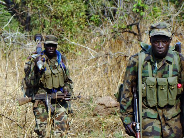 This photo taken on Dec. 16, 2010 shows Ugandan soldiers searching through thick vegetation around the Congolese jungle, a longtime hideout for renegade Joseph Kony, leader with a bounty on his head of the notorious Lord's Resistance Army infamous for brutal mutilations on its human victims.