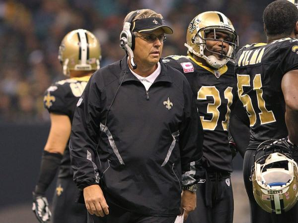 Defensive coordinator Gregg Williams of the New Orleans Saints talks to the defense during the game against the Pittsburgh Steelers at the Louisiana Superdome on October 31, 2010 in New Orleans, Louisiana. On today's Opinion Page, attorney Eldon Ham argues that athletes should face criminal charges for malicious attacks on the playing field.