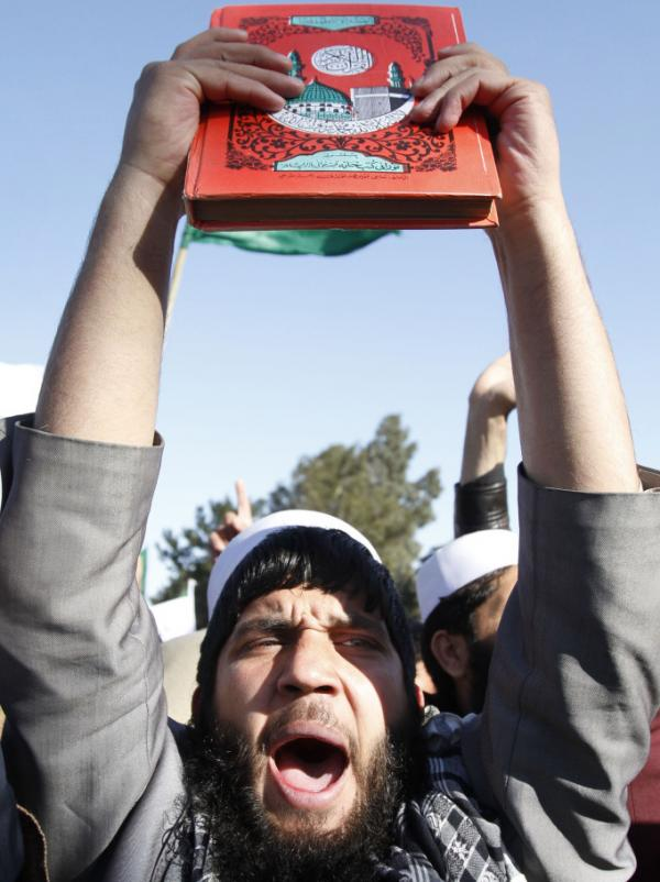 After U.S. troops burned Qurans last month, Afghans staged protests throughout the country. Here a demonstrator holds a Quran in the eastern city of Jalalabad on Feb. 22.