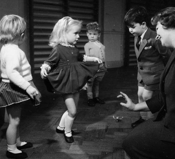 "Politeness seems to be falling by the wayside these days, with phrases like ""you're welcome"" replaced by the more casual ""you bet"" or ""no problem."" Good manners were more the norm in 1960, when these kids at a junior theatrical school learned how to curtsy and bow."
