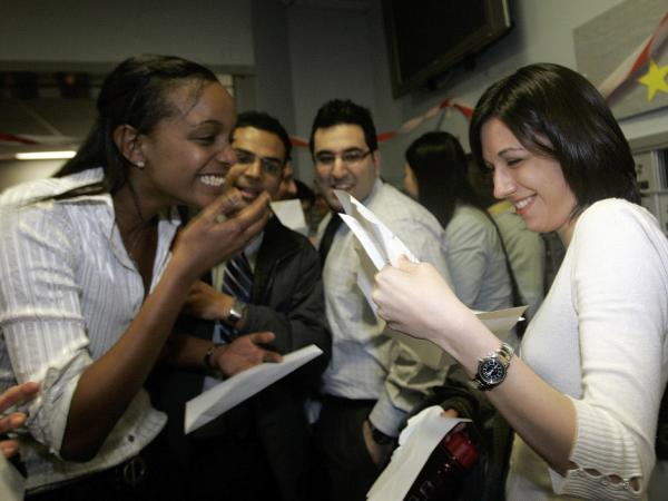 Boston University medical students Miriam Shiferaw (left) and Nawal Momani check letters together to find out where they have been accepted for their residencies during Match Day in 2007.