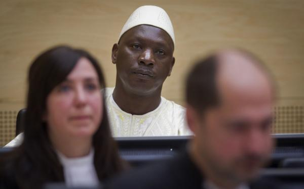 Congolese warlord Thomas Lubanga (center) at the International Criminal Court in The Hague, Netherlands, where he was convicted Wednesday of war crimes, including recruiting child soldiers.