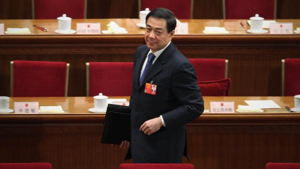 Chongqing Municipality Communist Party Secretary Bo Xilai leaves after the third plenary meeting of the National People's Congress at The Great Hall of the People in Beijing on March 9. Bo had been seen as a leading contender to access the top rungs of power in China, but in a dramatic reversal of fortune, he was sacked Thursday amid a rare public scandal.