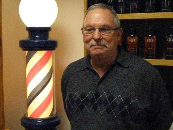 Ken Kirkpatrick, a barber at the Capitol Barber Shop in St. Paul, says he hopes Minnesota will ban salons from displaying the iconic barber pole in their shops if they don't have a barber on staff.