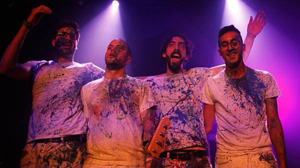 The paint-splattered members of Venezuelan rock band La Vida Boheme won over NPR Music's team on the second day of the SXSW festival in Austin, Texas.