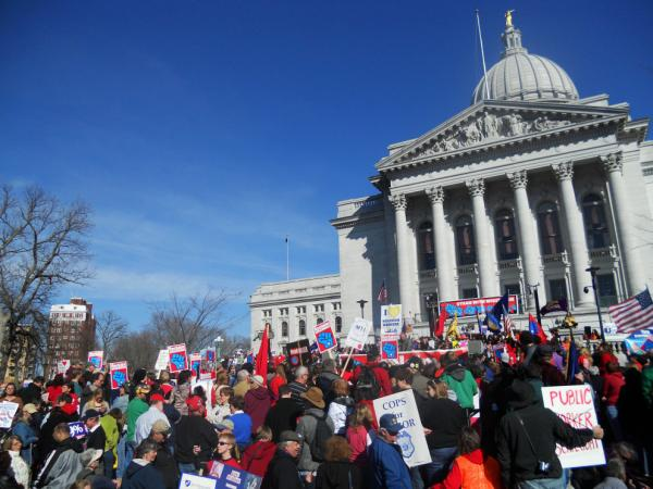 A Wisconsin GOP lawmaker facing a recall election called it quits Friday and said she hopes the state can get past scenes like this gathering of protesters in Madison on March 10, 2012.