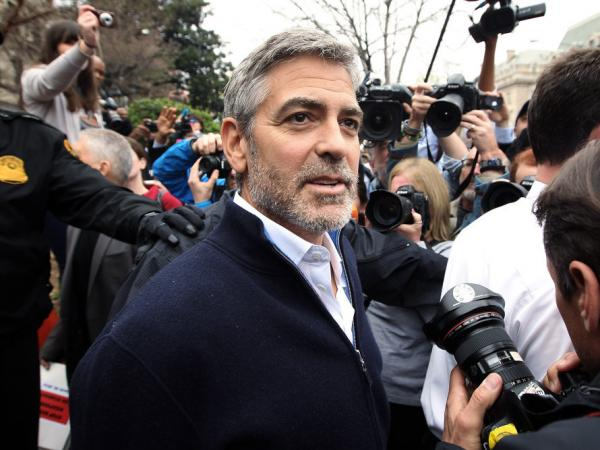 Actor George Clooney is arrested by members of the U.S. Secret Service Uniform Division during a protest outside the Sudanese Embassy March 16, 2012 in Washington, DC. Protesters organized against Sudanese President Omar al-Bashir's blockading of food and humanitarian aid in Sudan's Nuba Mountains and Blue Nile regions.