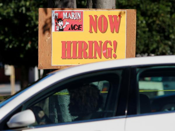 "A car drives by a ""now hiring"" sign that is posted outside of the soon-to-be-open Marin Ace Hardware store on Nov. 30, 2011 in San Rafael, California."
